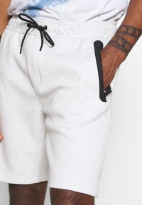 American Eagle - PULL ON WITH BONDED TAPE POCKETS - Pantaloni sportivi - heather frost - 4