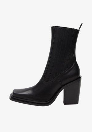 Vysoká obuv - schwarz