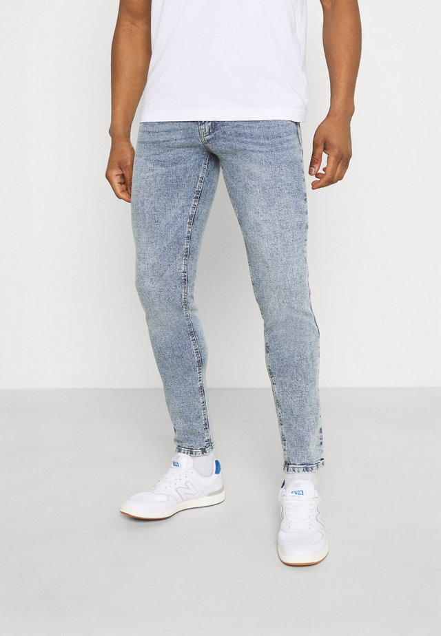 COPENHAGEN - Jeans slim fit - acid shade