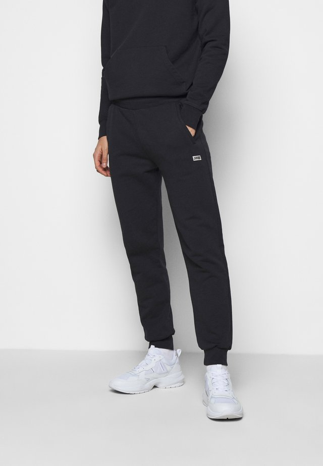 BOX LOGO PANTS - Tracksuit bottoms - black