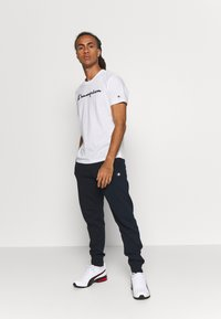 Champion - CUFF PANTS - Verryttelyhousut - navy - 1