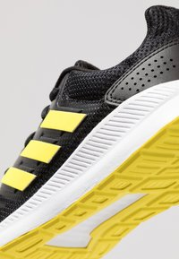 adidas Performance - RUNFALCON - Zapatillas de running neutras - core black/shock yellow