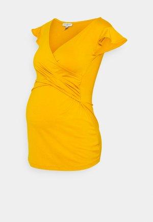 FRANCINE - Triko spotiskem - mustard