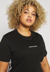 Calvin Klein Jeans Plus - PLUS TAPE DRESS - Jersey dress - black - 4