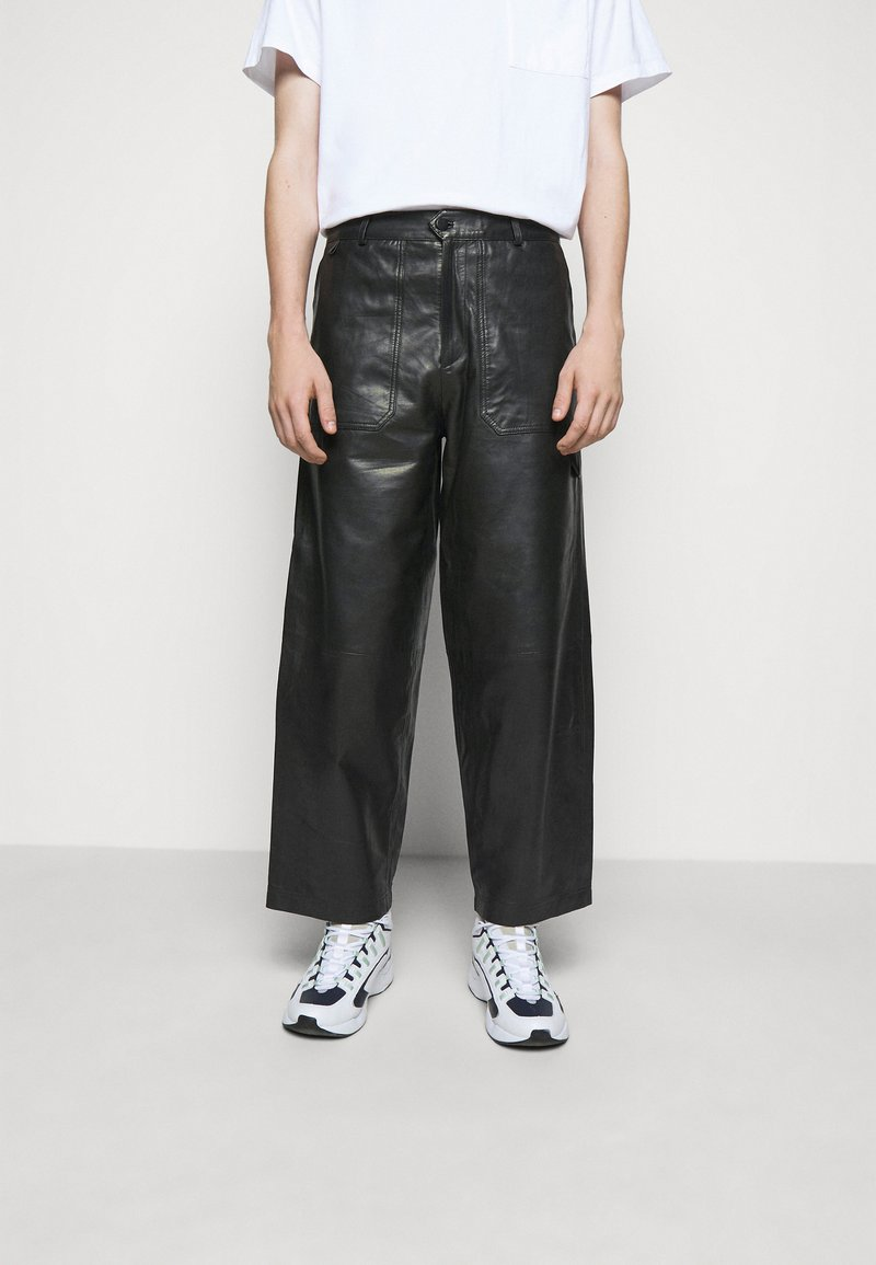 Holzweiler - TEFF TROUSER  - Leather trousers - black
