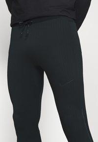 Nike Performance - SWIFT - Leggings - black - 4