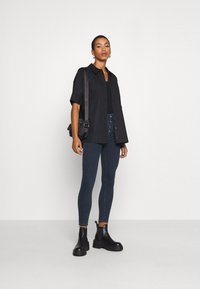 Calvin Klein Jeans - HIGH RISE SUPER SKINNY - Jeans Skinny Fit - dark blue denim - 1