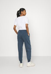 Topshop - ACID WASH JOGGER - Tracksuit bottoms - denim blue - 2