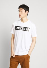 Timberland - T-shirt z nadrukiem - white - 0