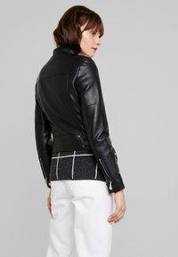 Vero Moda - VMEILEEN SHORT COATED JACKET - Faux leather jacket - black - 2