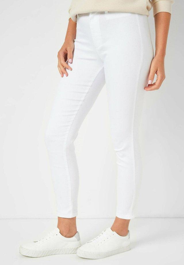 POWERSTRETCH - Trousers - weiß