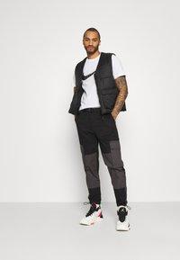 Topman - BELTED CARGO - Cargo trousers - black - 1
