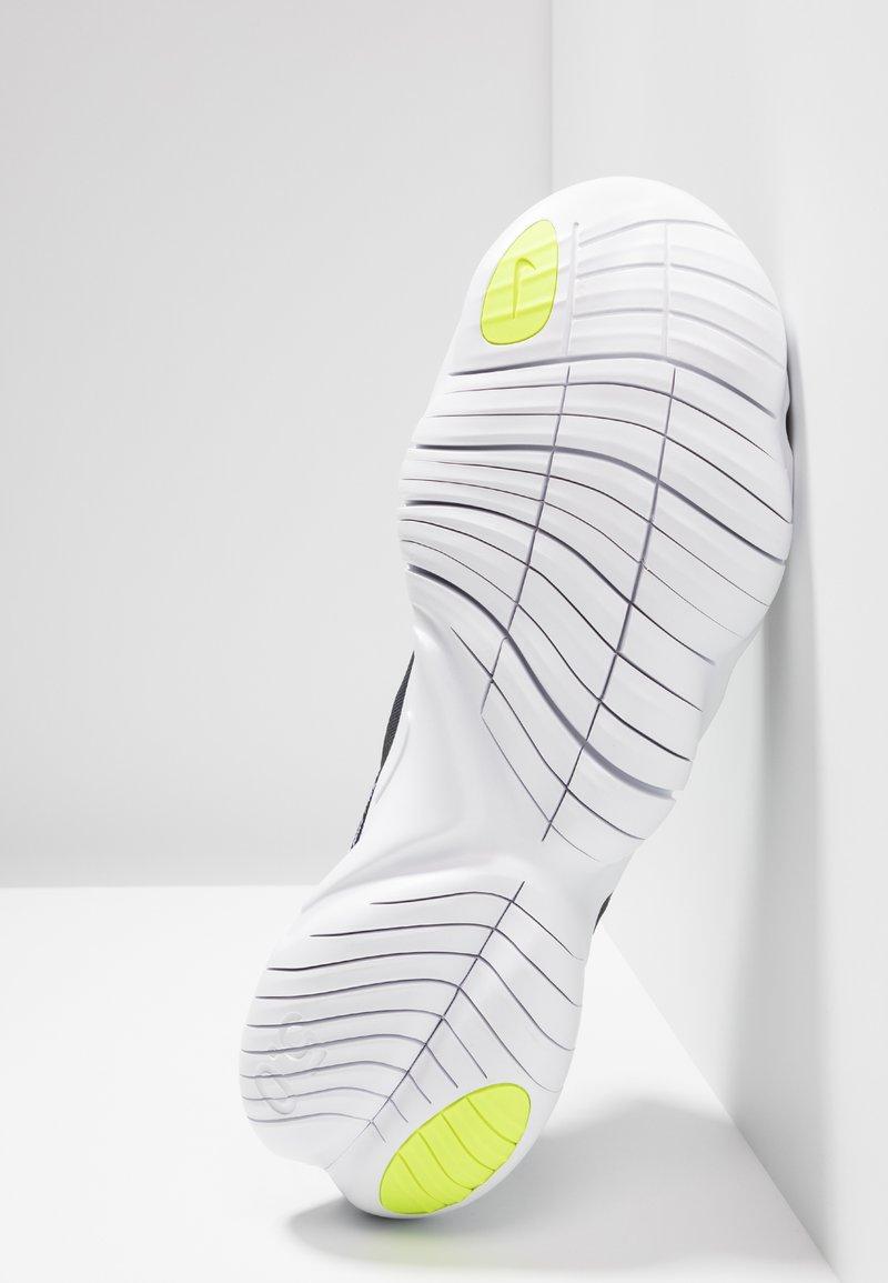 traidor Calle principal Separar  Nike Performance FREE RN 5.0 - Minimalist running shoes -  black/white/anthracite/volt/black - Zalando.co.uk