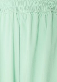 NA-KD - NA-KD X ZALANDO EXCLUSIVE - SPORTY FABRIC PANTS - Tracksuit bottoms - fresh mint - 5
