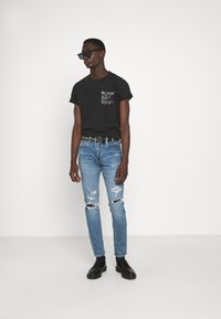 Levi's® - 512™ SLIM TAPER - Slim fit jeans - tabor crumble - 1