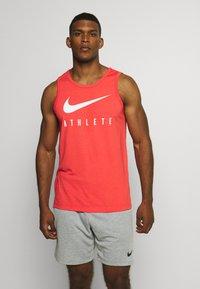 Nike Performance - TANK ATHLETE - Sports shirt - track red - 0