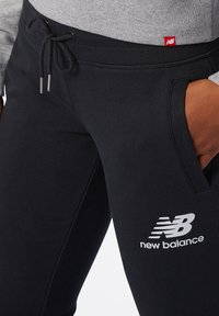 New Balance - Tracksuit bottoms - black - 3