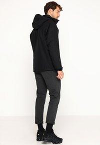 Helly Hansen - DUBLINER INSULATED JACKET - Waterproof jacket - black - 2