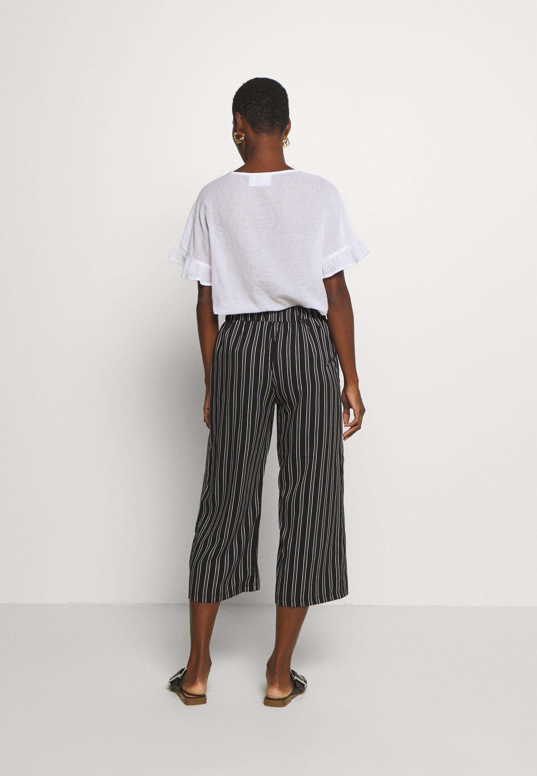Cartoon Pantalon classique - black/white - Pantalons & Leggings Femme cxcVD
