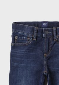 GAP - BOTTOMS SLIM - Slim fit jeans - dark blue denim - 4