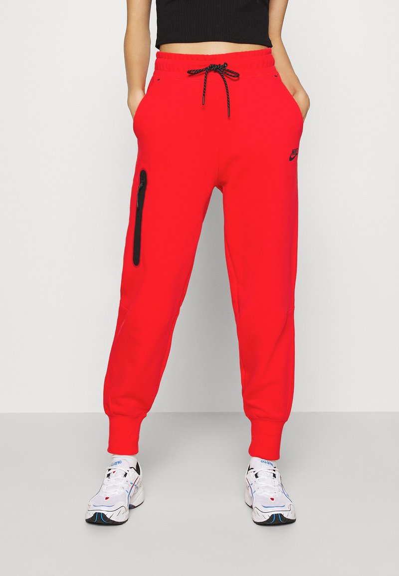 Nike Sportswear - Tracksuit bottoms - chile red/black
