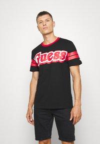 Guess - BARS TEE - Print T-shirt - jet black - 0