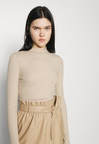 Vero Moda - VMMIA HIGHNECK BODY - Long sleeved top - beige - 3