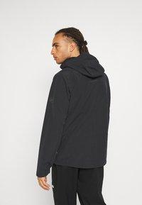 Mammut - TROVAT HOODED JACKET  - Hardshell jacket - black - 2