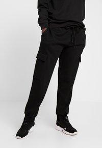 Urban Classics - LADIES CARGO PANTS - Tracksuit bottoms - black - 0