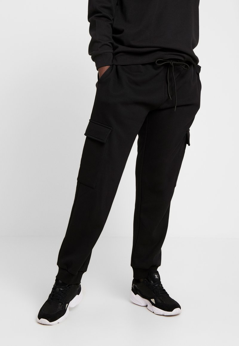 Urban Classics - LADIES CARGO PANTS - Tracksuit bottoms - black