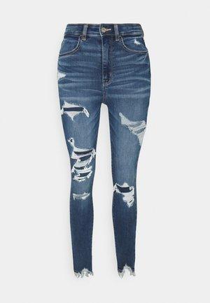 HIGHEST RISE JEGGING - Slim fit jeans - destroyed denim
