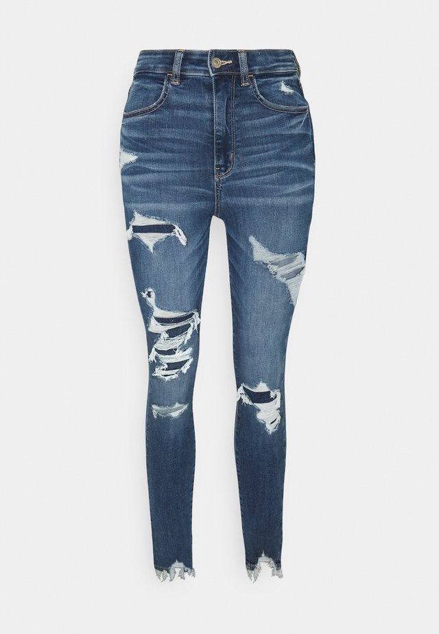 HIGHEST RISE JEGGING - Slim fit jeans - destroyed denim