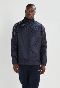 JAKO - TEAM - Waterproof jacket - marine - 0