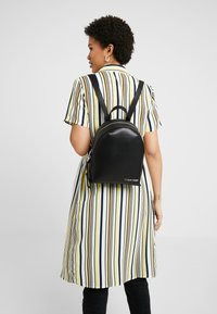 Calvin Klein - STRIDE BACKPACK - Rucksack - black - 1