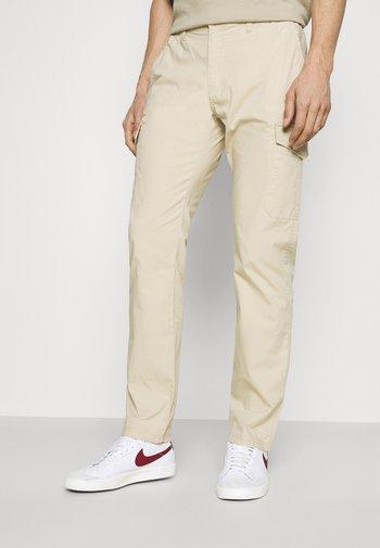 PANTS - Cargo trousers - sandy beige