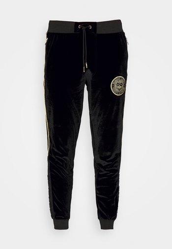 MAVINO - Pantaloni sportivi - black/gold