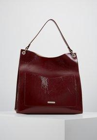 Rebecca Minkoff - RING TOTE - Tote bag - pinot noir - 0
