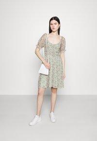 Vila - VIVOLETTE WILDY DRESS - Day dress - desert sage - 1