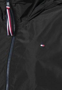 Tommy Hilfiger - CORY FUNNEL PACKABLE - Summer jacket - black - 2