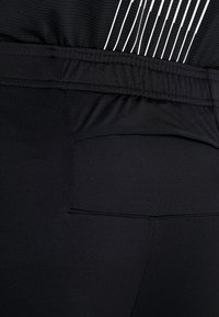 Nike Performance - ESSENTIAL PANT - Tracksuit bottoms - black/reflective silver - 3