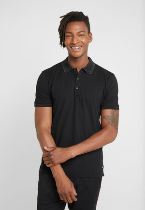 DINOSO - Polo shirt - black