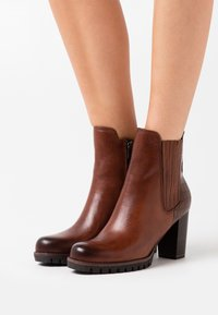 Marco Tozzi - BOOTS - High heeled ankle boots - cognac - 0