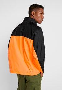 adidas Originals - REVEAL YOUR VOICE - Windbreakers - flash orange - 2