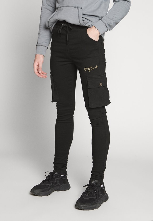 NIGHT COLLECTION - Trousers - black