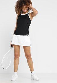 adidas Performance - CLUB TANK - Sports shirt - black - 1