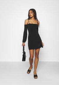 NA-KD - PAMELA REIF OFF SHOULDER MINI DRESS - Jersey dress - black - 1