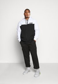 Calvin Klein - COLOR BLOCK ZIP HOODIE - Zip-up hoodie - black - 1