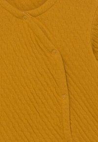 Sense Organics - YURI BABY WRAP UNISEX - Cardigan - mustard - 2