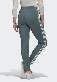 adidas Originals - PANTS - Tracksuit bottoms - hazy emerald - 2