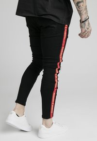 SIKSILK - BURST KNEE - Vaqueros pitillo - black - 2